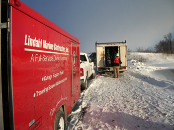 Working outdoors in cold weather. Dive unit along with an Outage Support Trailer