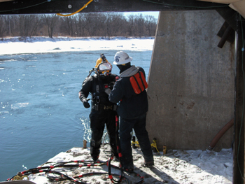 Diver preparing to enter icy water